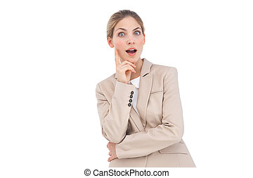 Astonished businesswoman looking at the camera