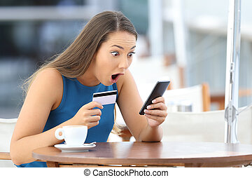 Astonished buyer finding offer on line in a bar - Single...
