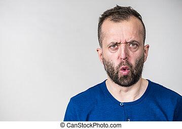Astonished shocked adult man