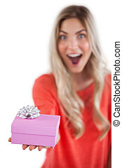 Astonished woman holding a gift