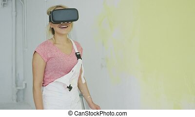 Astonished young woman in virtual reality headset