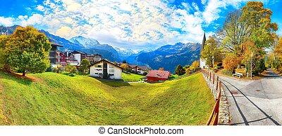 Astonishing autumn view of picturesque alpine village Wengen.