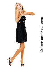 Beautiful amazed woman in black dress, isolated on white