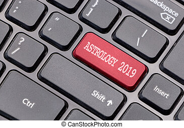Astrology 2019 red on enter key, of a black keyboard.