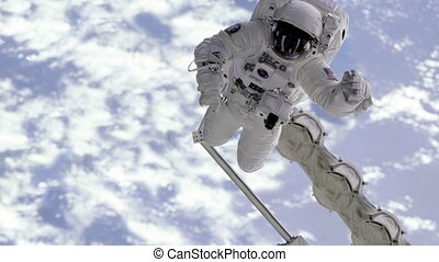 """Astronaut are moving in the camera in outer space"""