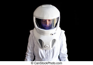 Astronaut in a helmet looks down. Fantastic space suit....