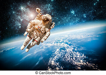 Astronaut in outer space against the backdrop of the planet ...