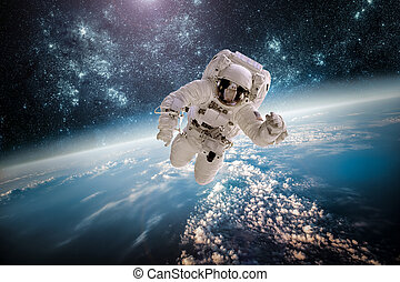 Astronaut in outer space against the backdrop of the planet...