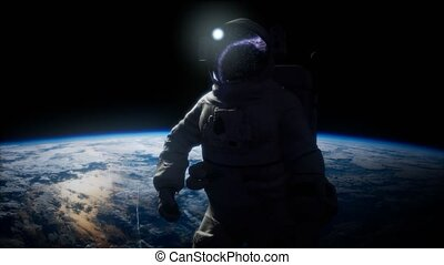 Astronaut in outer space against the backdrop of the planet earth