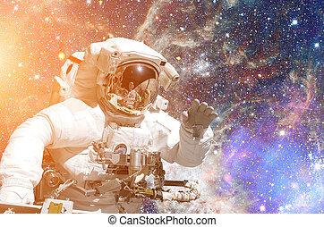 Astronaut in outer space. Galaxy and stars on the background.