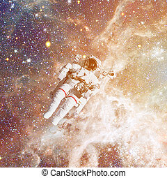Astronaut in outer space. Nebula and stars on the background.