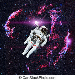 Astronaut in outer space. Nebula on the background. Elements...