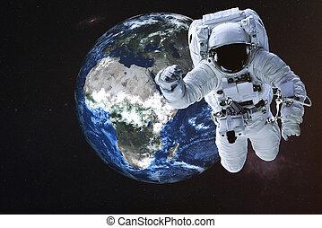 Astronaut near the Earth planet