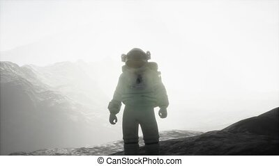 astronaut on another planet with dust and fog