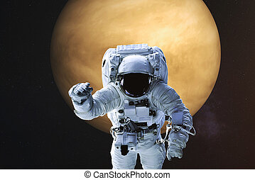 Astronaut on the background of Venus