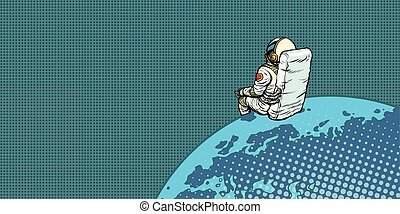 astronaut sits on the planet Earth