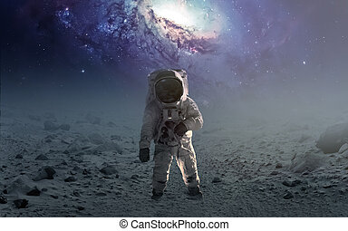 Astronaut walking on an unexplored planet. Elements...