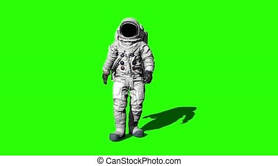 Astronaut walking on the Green Screen and saluting. -...