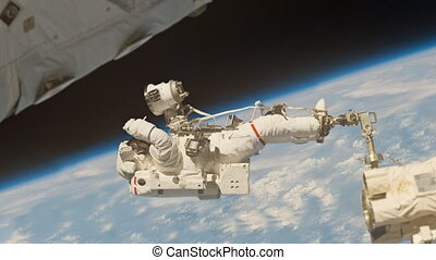 Astronaut working in deep space.