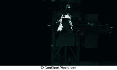 Astronaut working on the ISS. Realistic 4K animation. -...