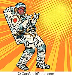 Astronaut young man points. African American people. Pop art retro vector illustration kitsch vintage drawing