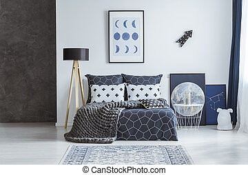 Astronomical poster in bright bedroom interior