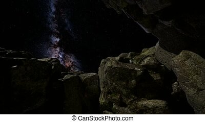 Astrophotography star trails over sandstone canyon walls....