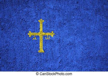 Asturias flag painted on the cracked grunge concrete wall