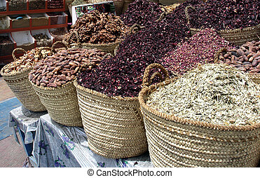 Aswan Cityscape - Spices on display in Aswan Market, Egypt.