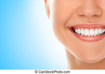 At a dentist with a smile - A woman is smiling while being...