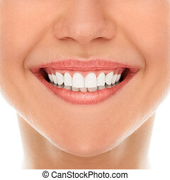A woman is smiling while being at the dentist