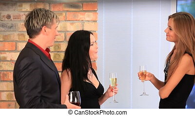 Raising glasses in a toast at a formal party