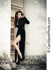 At a manor - Beautiful young lady in black dress at old...