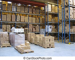 nside a warehouse. Pallets are plased on the ground, and there are shelves with pallets in the background and to the right.