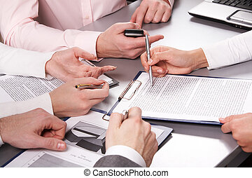 At briefing - Photo of business people hands working with...