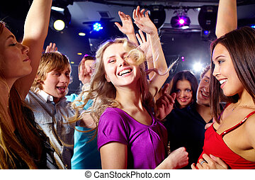 At disco  - Image of happy young girls having fun at disco