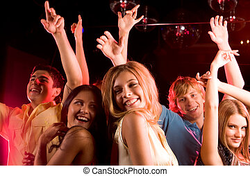 At disco  - Image of happy young people having fun at disco