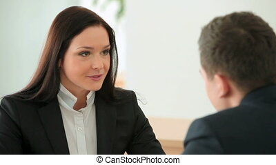 At job interview - Young man undergoing a job interview for...