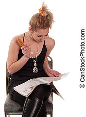 At leisure - Young woman reading newspaper and eating roll...