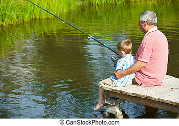 At leisure - Photo of grandfather and grandson sitting on...