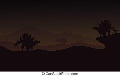 At night Stegosaurus in hills scnery