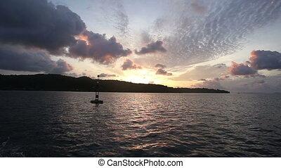 ship sails past the island