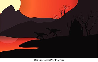 At sunset eoraptor silhouette in lake