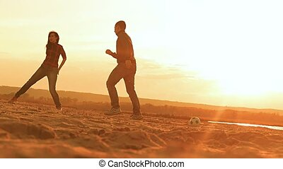 at sunset man chasing a soccer ball Popescu game slow motion...