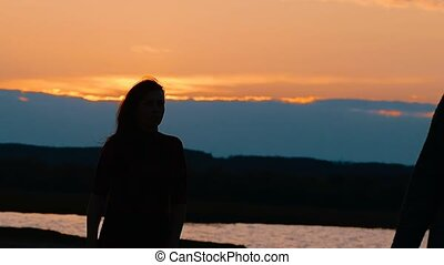 at sunset silhouette of a girl slow motion video