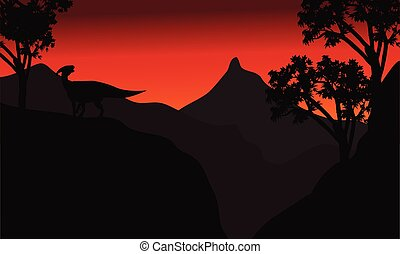 At sunset silhouette parasaurolophus in cliff
