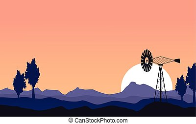 At sunset windmill silhouette scenery