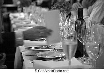 at the beginning of official dinner in restaurant