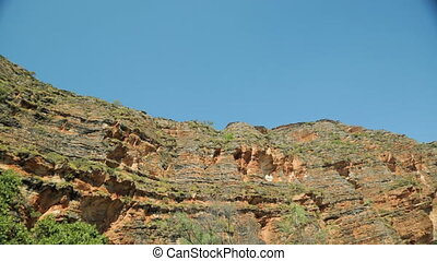 At the bottom of an outback ravine - A sweeping panning shot...