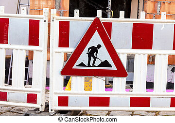 at the construction site - hedge the road at a construction...